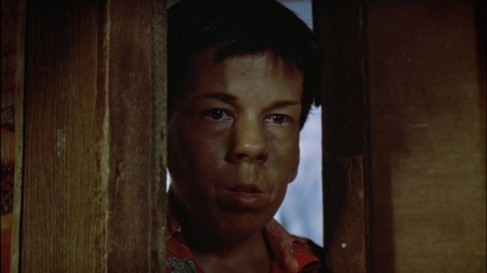 Linda Hunt transforms into a man called Billy Kwan.