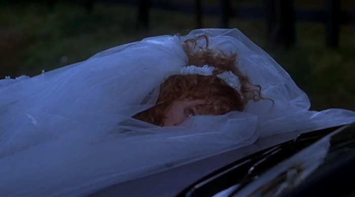a bride inside the wedding dress, a one and only Joan Cusack